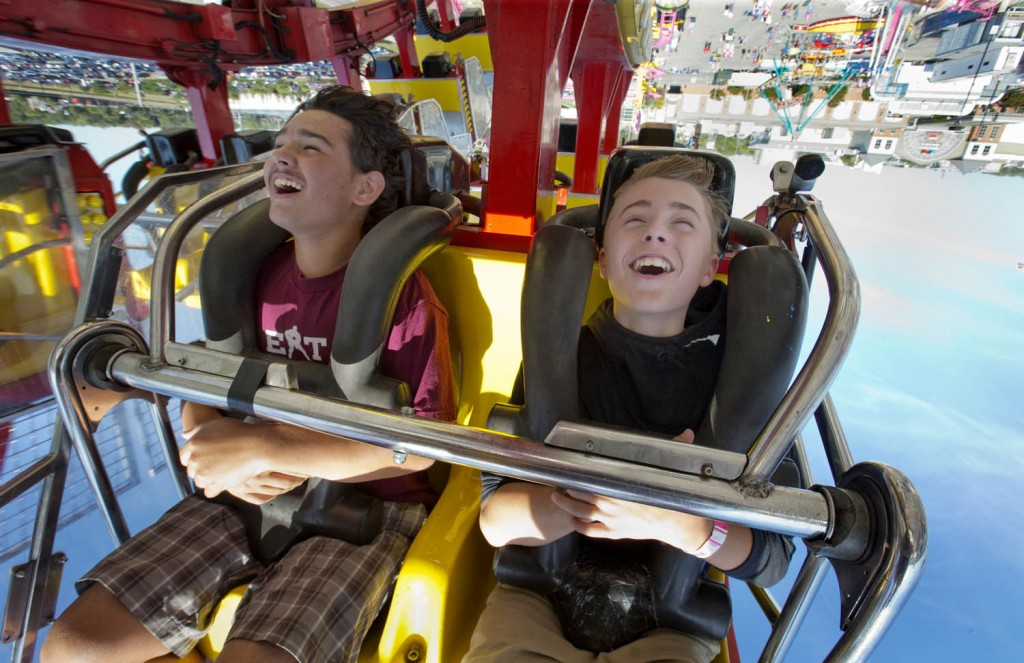 Quinn Wenger and Gabe Gurd ride the Banzai, a looping ride that sees riders get some serious hang time, at the Western Fair in London, September 15, 2015 (Craig Glover/The London Free Press)