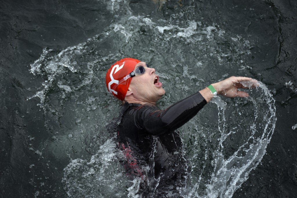 A racer swims in the Welland Canal during the Rose City Triathlon on June 14, 2015 (Franki Ikeman/Welland Tribune)