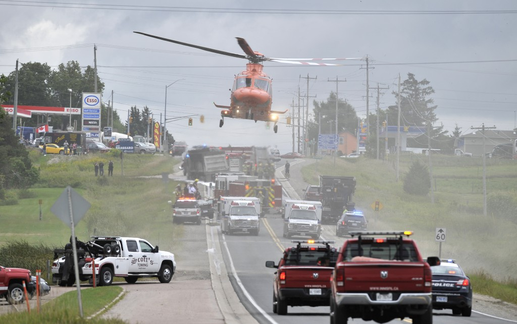 At least one person was taken away by air ambulance after a crash between a dump truck and car (Mark Wanzel/Barrie Examiner)