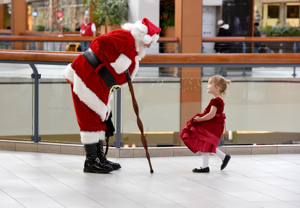 Two year-old Sydney Maas was first in line at Lime Ridge Mall to meet Santa (Cathie Coward/ Hamilton Spectator)